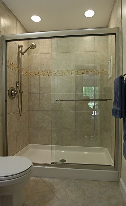 Small bathroom tile designs with kohler fluence frameless for Bathroom door ideas