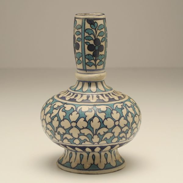 "Islamic pottery vase with various blue and white floral decoration. 8""H."