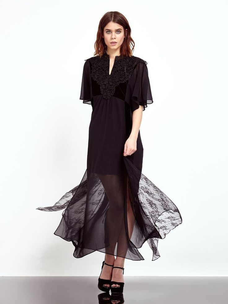 This chiffon maxi dress is packed with texture – black velvet & chiffon panels are layered with tonal lace appliqué, and an asymmetrical cut. Lined to m...