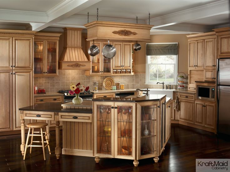 This traditional kitchen with kraftmaid cabinetry and a multi tiered island provides a balance - Kraftmaid bathroom cabinets catalog ...