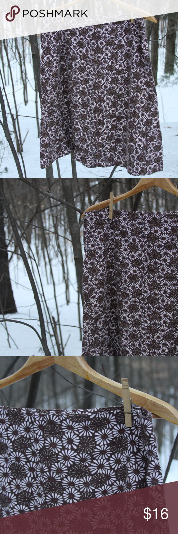 """Springy flowered linen/cotton skirt Springy flowered linen/cotton A-line skirt. Side zipper Brown & white flowers with a magenta center. 55% Linen, 45% Cotton.  Waist 34"""" Overall length from waist to hem 24 1/2""""  All orders come with a free handmade lavender sachet! Eddie Bauer Skirts Midi"""