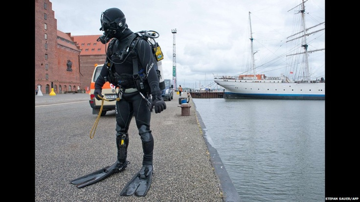 A police diver stands at the port of Stralsund
