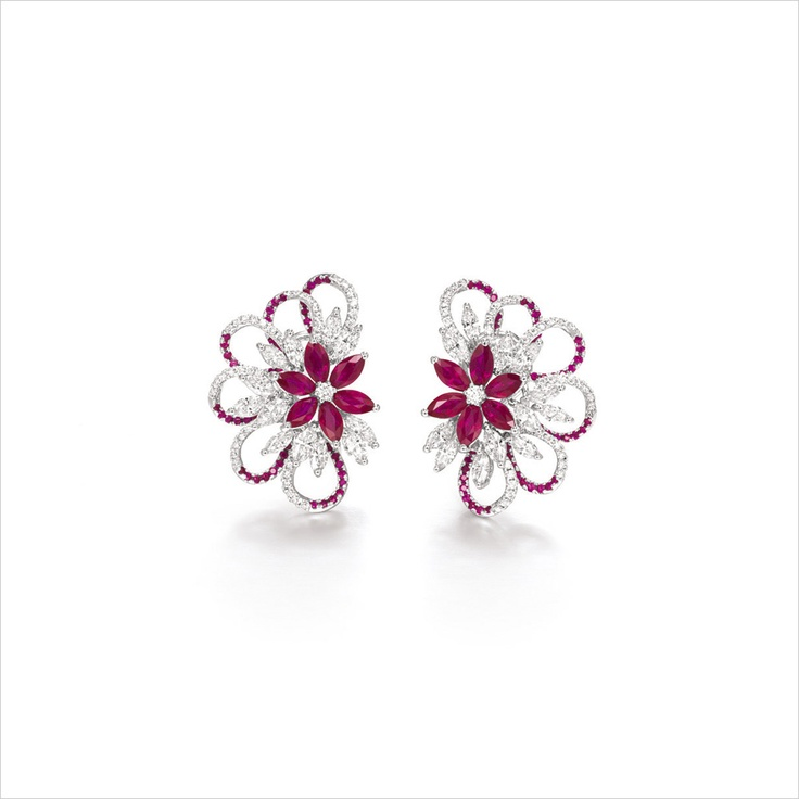 RUBY AND DIAMOND EAR CLIPS Of floral design, each set with clusters of marquise-shaped rubies and diamonds, to a swirl set by circular-cut rubies and diamonds
