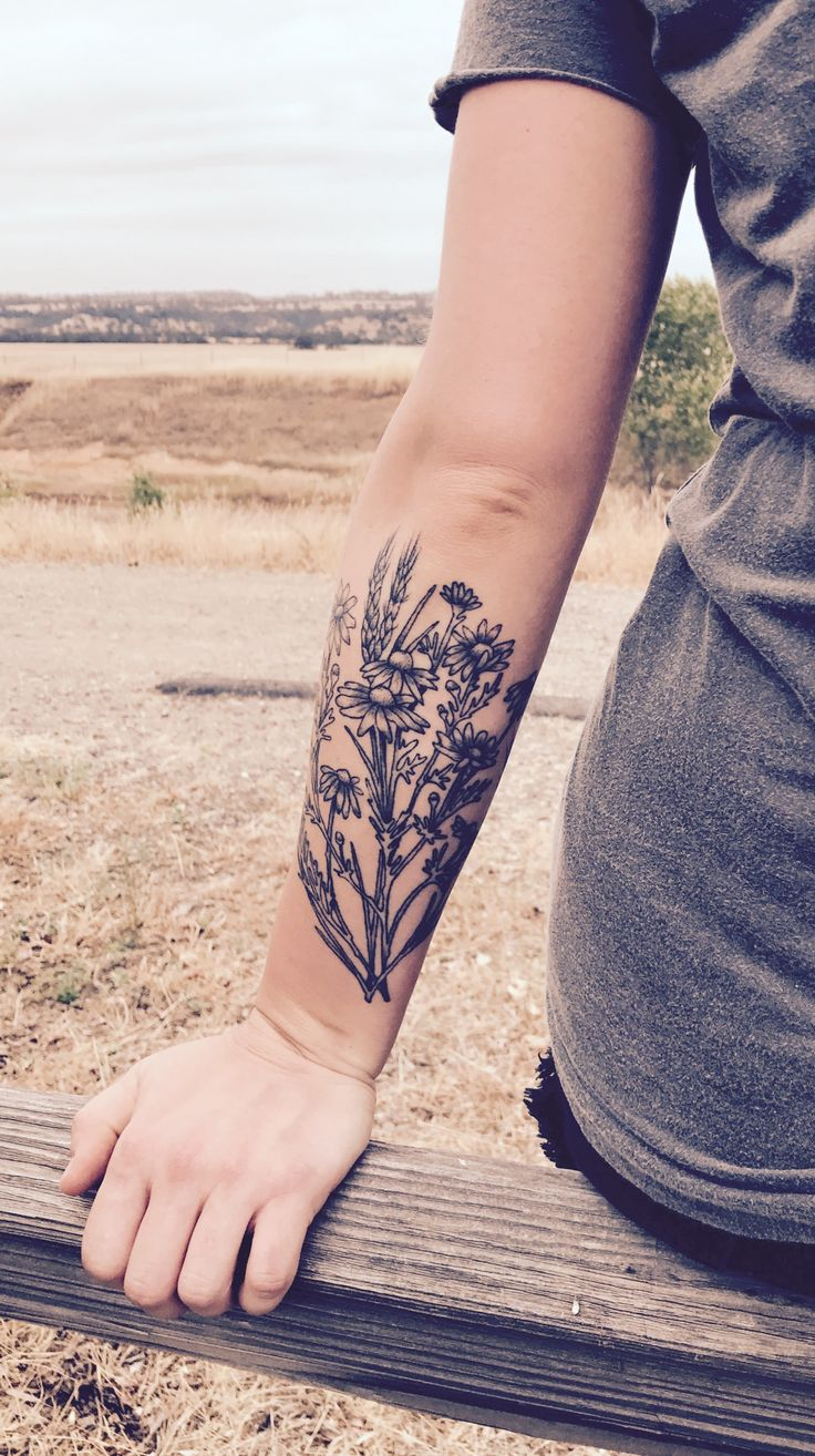 Chamomile & wheat.  floral forearm tattoo. Black & grey.