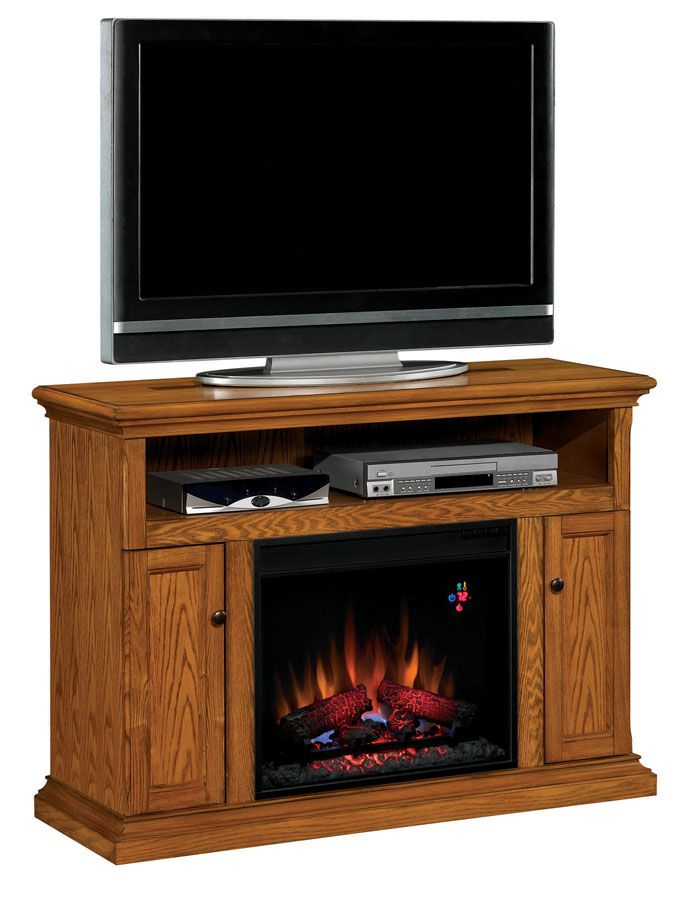 The Cannes Antique Oak Entertainment Center Electric Fireplace brings together a family room like no other fireplace with its combination of warmth and entertainment.  Large 47.25 mantel holds nearly any flat screen TV on the market.  With open spaced center media shelf, storage for multiple c...