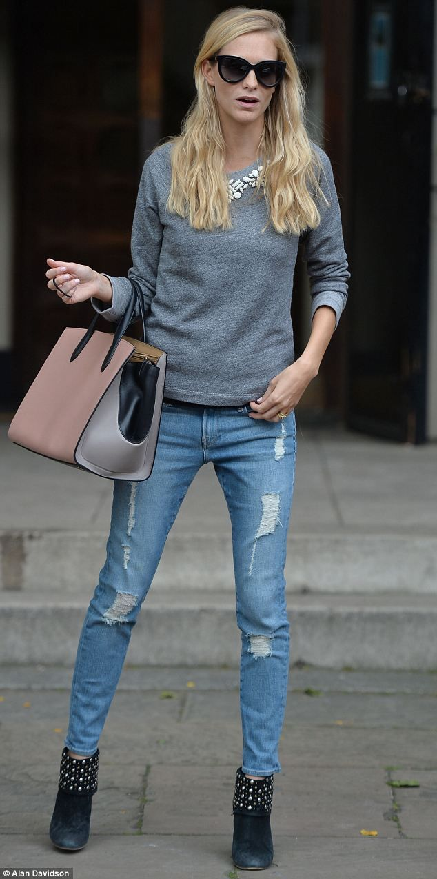 Poppy Delevingne looked casually stylish in an embellished sweater and ripped jeans
