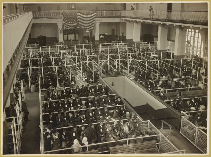 The pens at Ellis Island, main hall. These people have passed the first mental inspection. (Edwin Levick)
