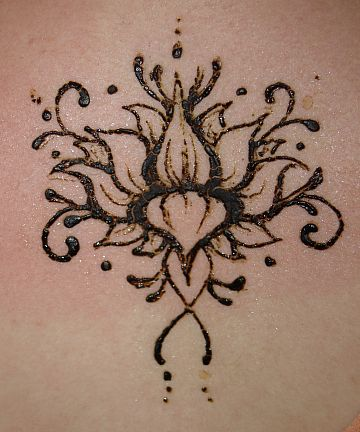 Lotus blossoms are a favorite when it comes to henna tattoos, and this one is no different. This one is beautiful. It is an opening up lotus, and the detail ...