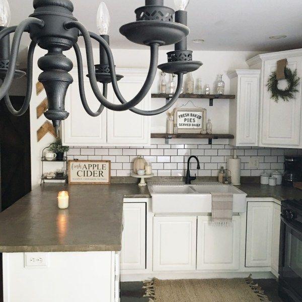 White cabinets, subway tile, concrete counter, farmhouse sink DIY concrete countertops