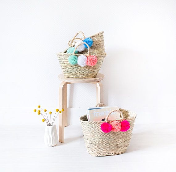 POM POM BASKET  our handwoven baskets adorned with pom poms add a playful pop of color to any space.  size: 15 x 11 x 9 (because each basket is