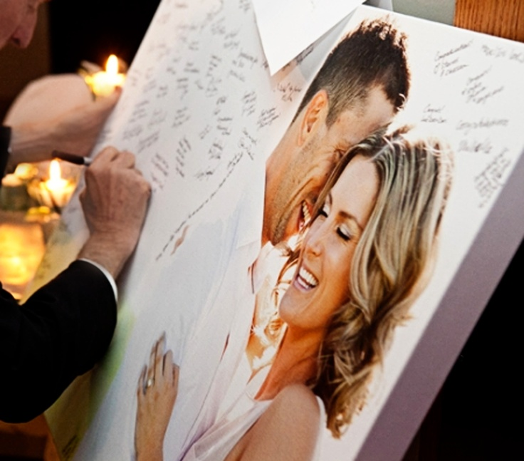 Have your guests sign a canvas with a picture of the two of you on it