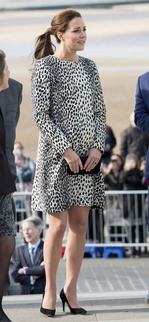 In a Hobbs coat. See all of Kate Middleton's best maternity looks.