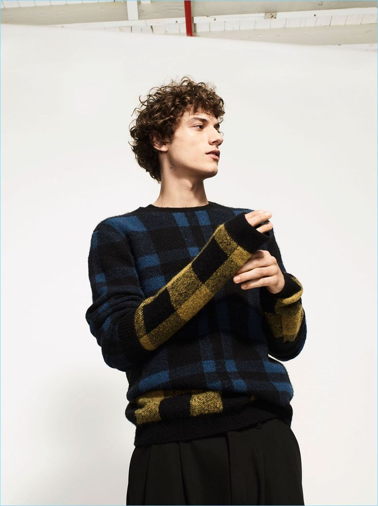 Model Serge Rigvava dons a check sweater with Zara Man trousers.