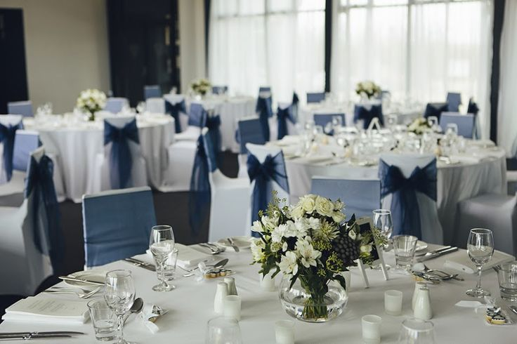 Simple and classy blue wedding. Flowers on a bowl as simple table centerpiece