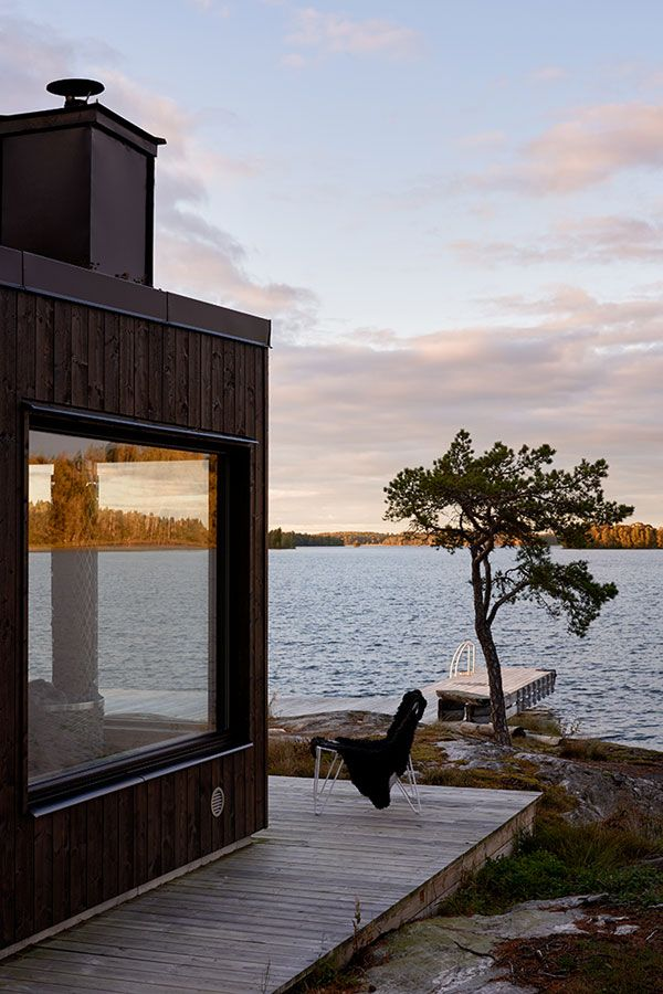 Nestled between the pine trees on the shores of a lake this semi-circular Swedish summerhouse is my idea of a peaceful weekend get-away.
