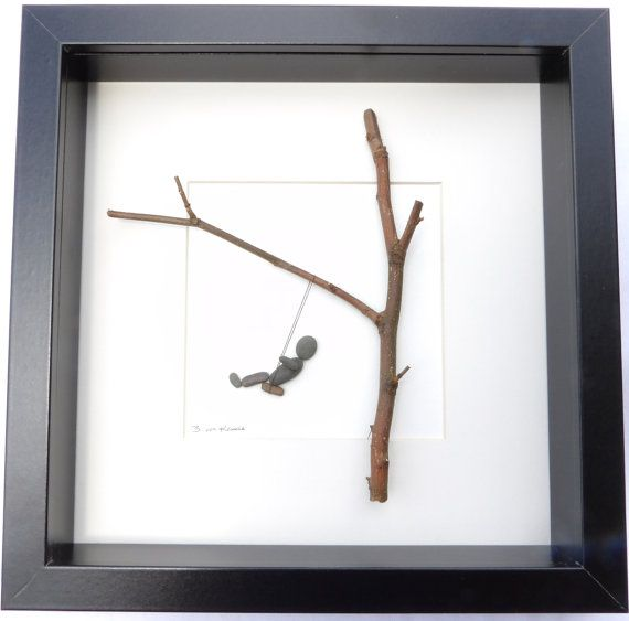 Beautiful pebble picture with swing motif using a mixture of natural materials.  In this picture we have a little pebble person mid swing on a swing hung from a twig sized tree.  It is made in the Scottish Borders using natural materials gathered locally.. Using natural material means that no two pictures will ever be quite the same, making this a completely unique addition to any room.  The picture size, including frame, is 25x25cm  If you are outside the UK, please contact me for shipping…