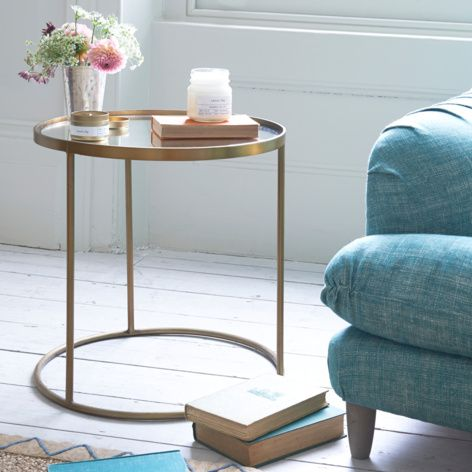 Contemporary style round and bronze Eclipse side table