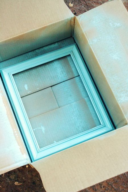 Frame Spray Painting Tip: place the frame in a box, and spray one side of it with your choice of spray paint. Leave it in the sun to dry, and then flip it over and spray the other side