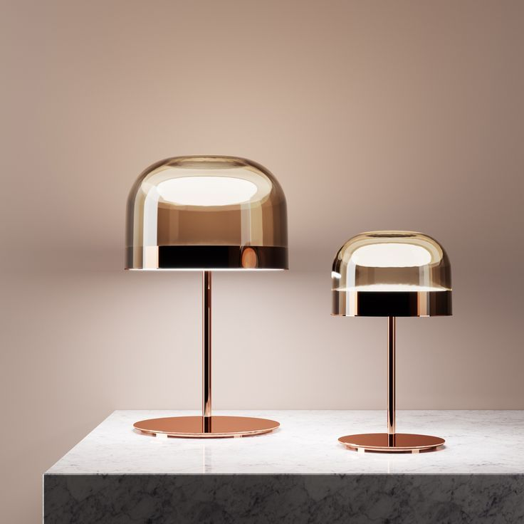 Equatore is a contemporary reinterpretation of the classic lamp with a glass shade. While the traditional abat-jour uses the shade to contain the light source...