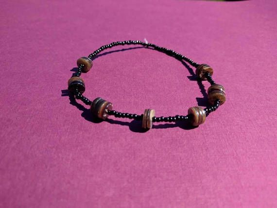Check out this item in my Etsy shop https://www.etsy.com/listing/550667751/mens-brown-shell-braceletbeach-bracelet