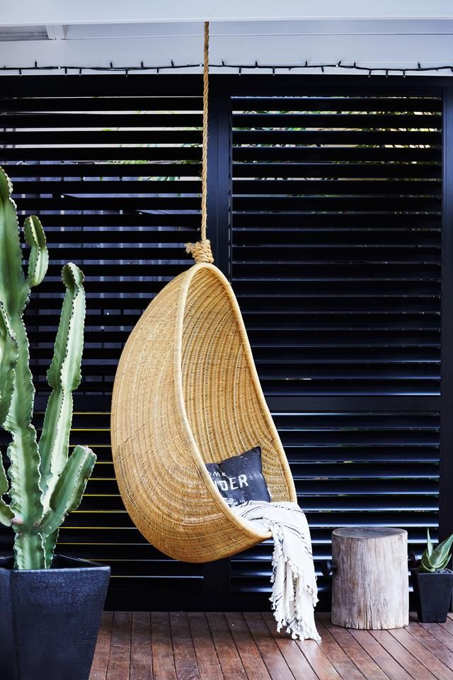 Hanging egg chair from a renovated workers cottage in Brisbane. Photo: Alicia Taylor | Styling: Jacqueline Kaytar | Story: real living