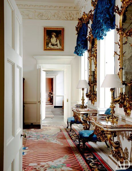 The chinoiserie mirrors in the Blue Drawing Room are by William Mathie, and the gilt-wood pier tables are the work of George Mercer.