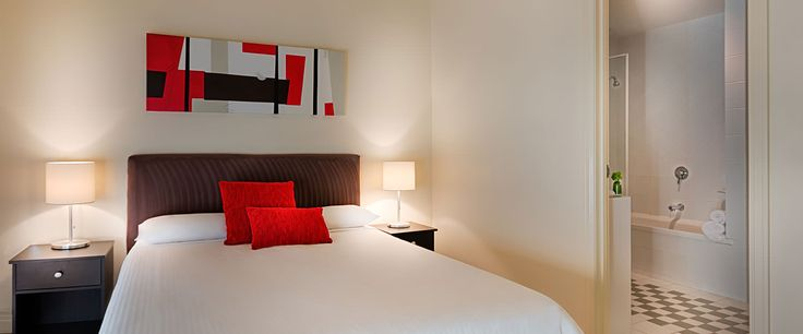 Caroline Serviced Apartments South Yarra - Two Bedroom Deluxe apartment bedroom and bathroom