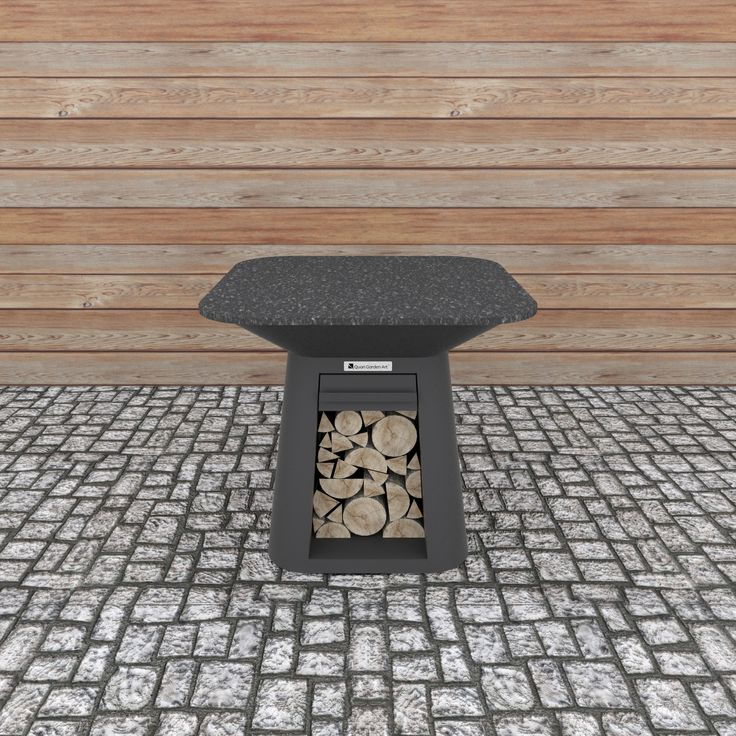 Rondo Table Carbon  Large side table for Quan Rondo. Provides space for food preparation and accessories during cooking. Includes easy to clean granite top and a drawer. Does not include a fireplace.  Dimensions (mm): H 900 W 1000 D 1000
