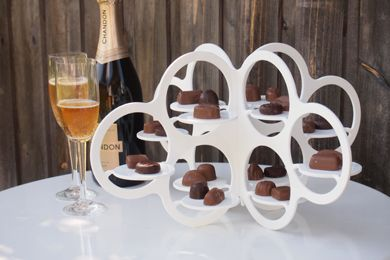 Cupcake Cloud. This modern and unique cupcake stand is designed by Sydney based product designer Stephen Procter. It folds into 2 pieces for easy storage. It makes a stunning table centrepiece for a wedding or birthday or a great gift for someone special.