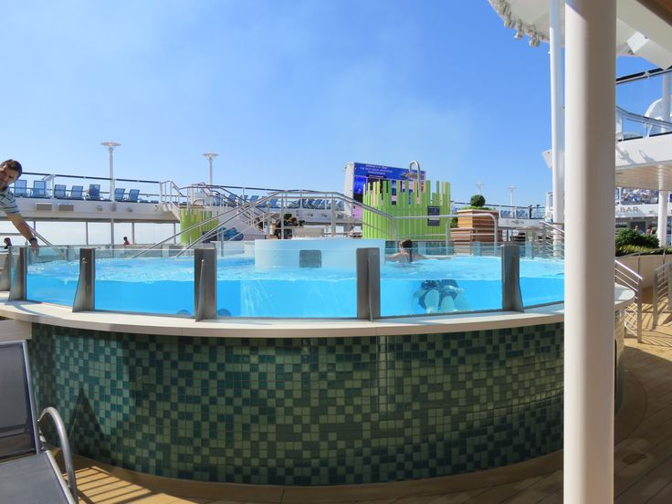 Royal Caribbean International - Naming of Athem of the Seas - Deck 14 exterior view of the swimming pool.