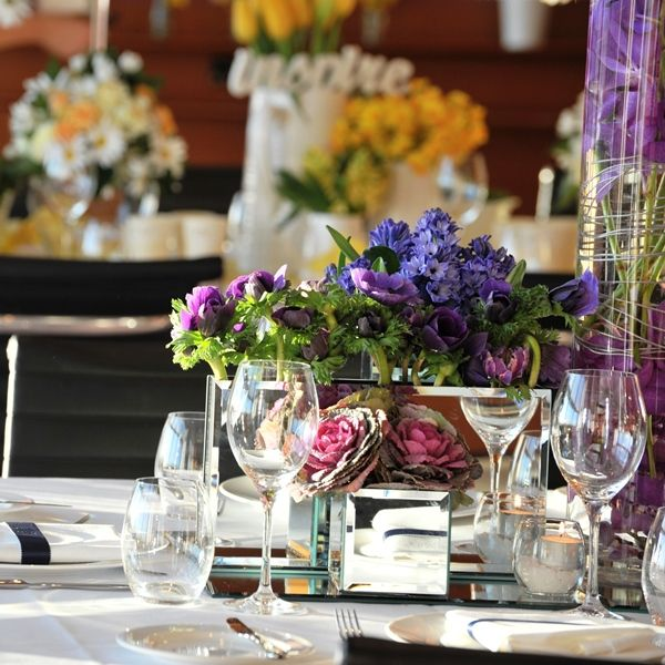 Colourful boardroom table flowers. For more wedding flower designs please go to www.naomijones.com.au.