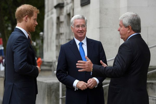 Prince Harry Photos - Britain's Prince Harry is greeted by Defence Secretary, Michael Fallon and the Chair of the Royal Foundation, Keith Mills, as he arrives to speak at an event on mental health at the Ministry of Defence (MoD) on October 9, 2017 in London, England. - Prince Harry & Sir Michael Fallon Speak at the MOD