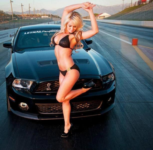 blonde in black bikini with a black ford mustang babes. Black Bedroom Furniture Sets. Home Design Ideas