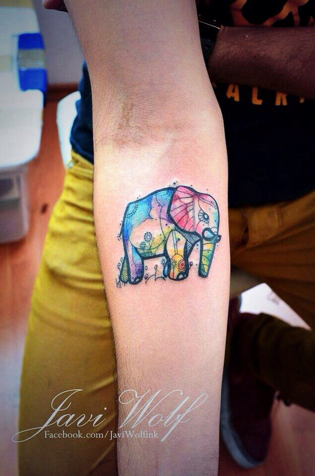 Small Watercolor Elephant Tattoo. The Elephant symbolically represents reliability, dignity, pride, power, & royalty. Also represents happiness, longevity, & good luck in the Asian meaning. Watercolor BC it's beautifully out of line & slightly risky. Placement: Unknown.