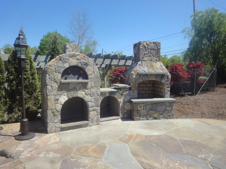 "36"" Contractor Series Outdoor Fireplace Kit with Amerigo Pizza Oven with wood storage box option."
