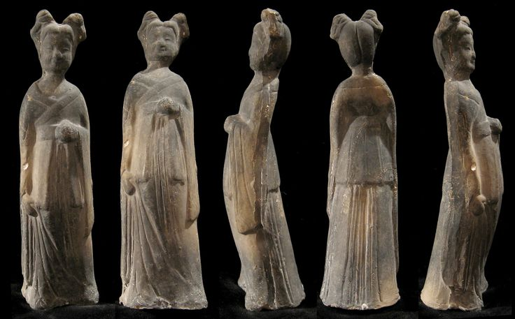 Chinese Wei Dynasty (386-535 AD) finely-detailed court attendant. She has a pleasant smile, her held head back, with hair up in two buns. Her right arm hangs at her side, left arm held up with robes draped over.