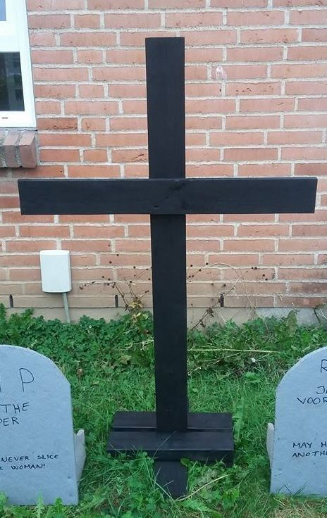 Cross carved in wood and spraypainted black.