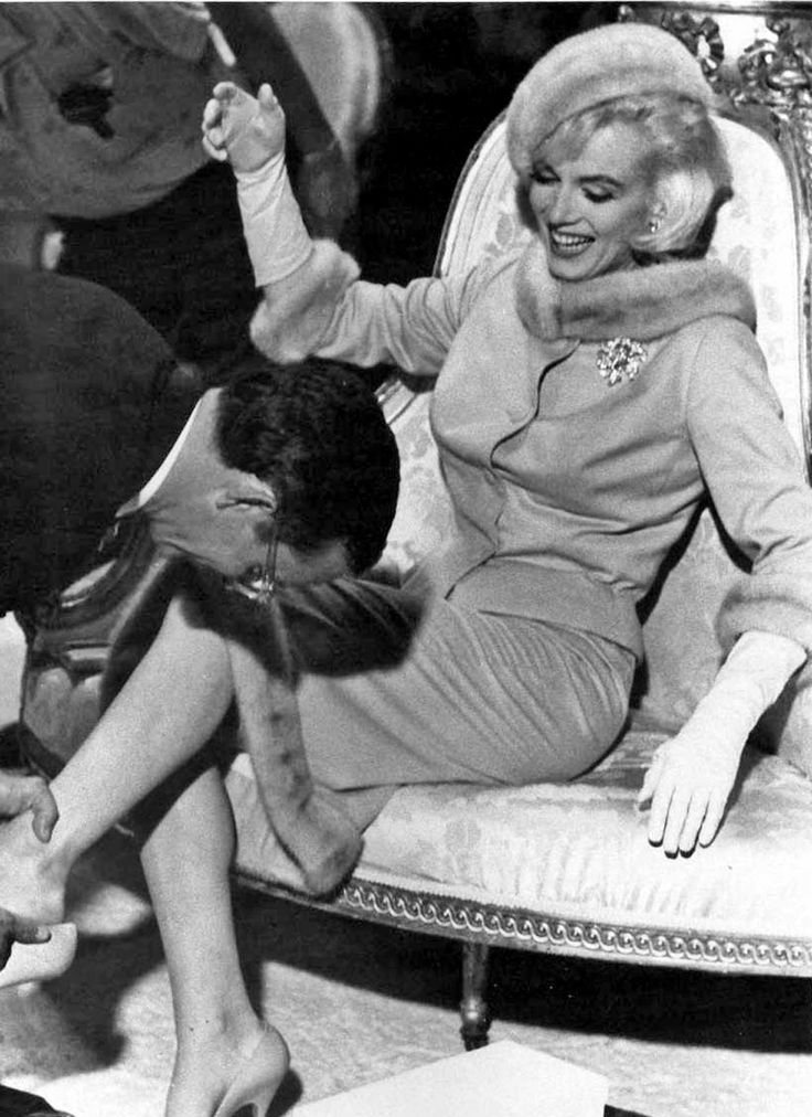 """Marilyn Monroe & Wally Cox in """"Something's Got To Give"""" 1962.  Her suit was made of camel-colored cashmere and trimmed in mink, with a matching mink hat. Luxe and beautiful."""