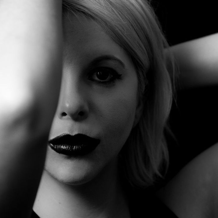High contrast black and white female portrait woman with platinum hair