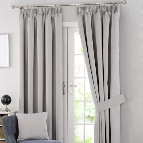 Designed with a subtle grey tone and a classic pencil pleat header, these ready made curtains are fully lined with blackout properties to retain warmth and redu...