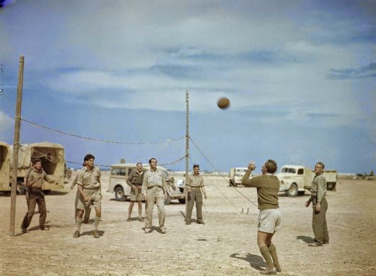 South African pilots play volleyball in Tunisia, 1943. -
