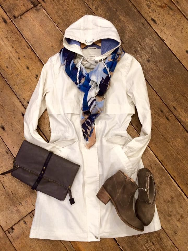 Given the fact the weather is a bit wet today, we are brightening up your spirits with this sophisticated white raincoat from Sandwich £199.00, beautiful blue InWear scarf £44.95, these 'must have' Cara ankle boots for £99.95 and stylish sandwich clutch bag £39.00 to complete this outfit.