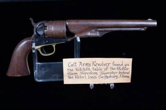 On exhibit at The Gettysburg Museum of History. A Civil War Colt Army Revolver left on the kitchen table of the Pfeffer Farm during the battle of Gettysburg. The Pfeffer family fled with their animals like many farmers in Gettysburg to keep the horses from being taken by the Confederates. When they returned they found their farm looted and ransacked. On their table was this working pistol left by the fleeing soldiers. This gun has been in the hands of the Pfeffer descendants ever since
