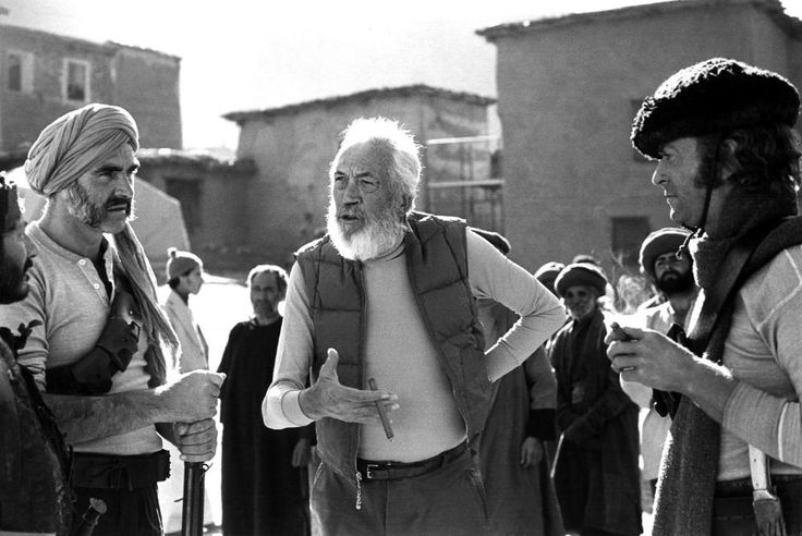 Michael Caine and Sean Connery with Director John Huston on the set of 'The Man Who Would Be King (1975)'. Huston is a Hollywood legend, having been nominated for 15 Oscars (won twice) for acting, directing, and writing. He even voiced the role of Gandalf in the 1977 animated film 'The Hobbit'.