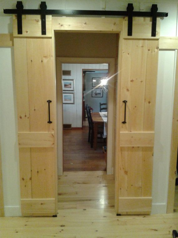 Barn door style interior sliding doors by for Sliding panel doors interior