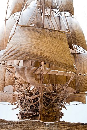 A totally unique scale model of the First Rate ship of the Line; Lord Nelson's Flagship HMS Victory; created by sculptor and woodcarver Ian G Brennan. The carving has taken almost 6000 hours of work and although it may look rather fragile, being carved entirely from centuries old original English oak removed from the lower gun deck of HMS Victory it is exceptionally strong. http://www.victorysculpture.com/