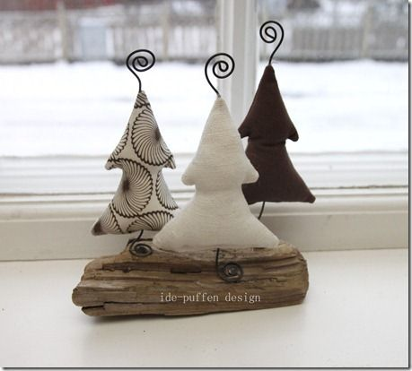 ♥ simple fabrics, simple tree shape.  Bendable wire (I assume) starts with base which is angled to be flat; then through the tree and out at top & curled.  No instructions at site.  Uses wood findings, naturals, reds and/or whites.