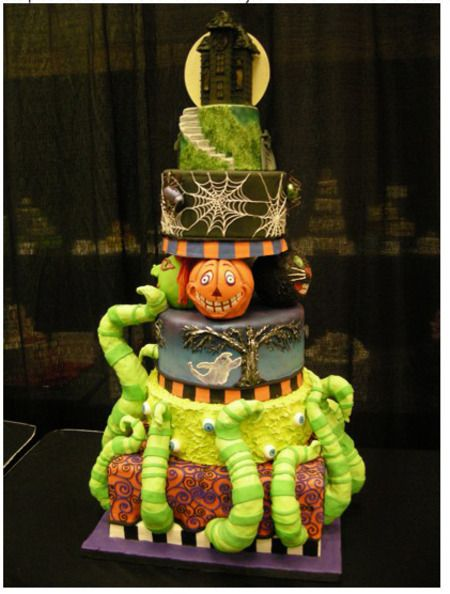 I LOVE the tentacles coming out of the bottom cake!  Each tier could be done in its own right but together it's a perfect over the top Halloween cake