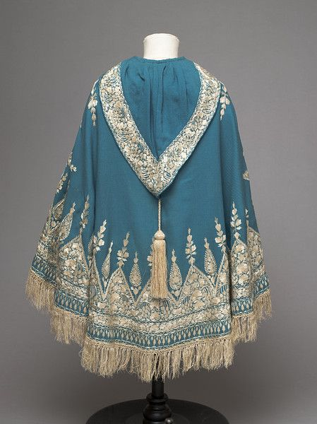 Twilled peacock blue woollen cloth, embroidered in cream silk thread, with a…