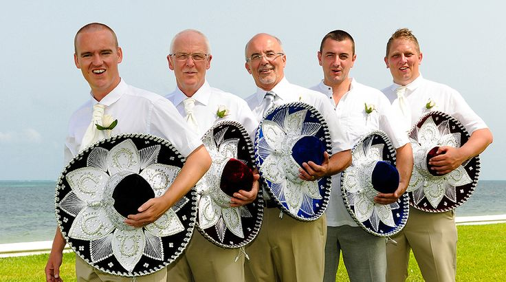 The groom and the groomsmen embrace the Mexican destination wedding with beautiful sombreros | Palace Resorts Weddings ®